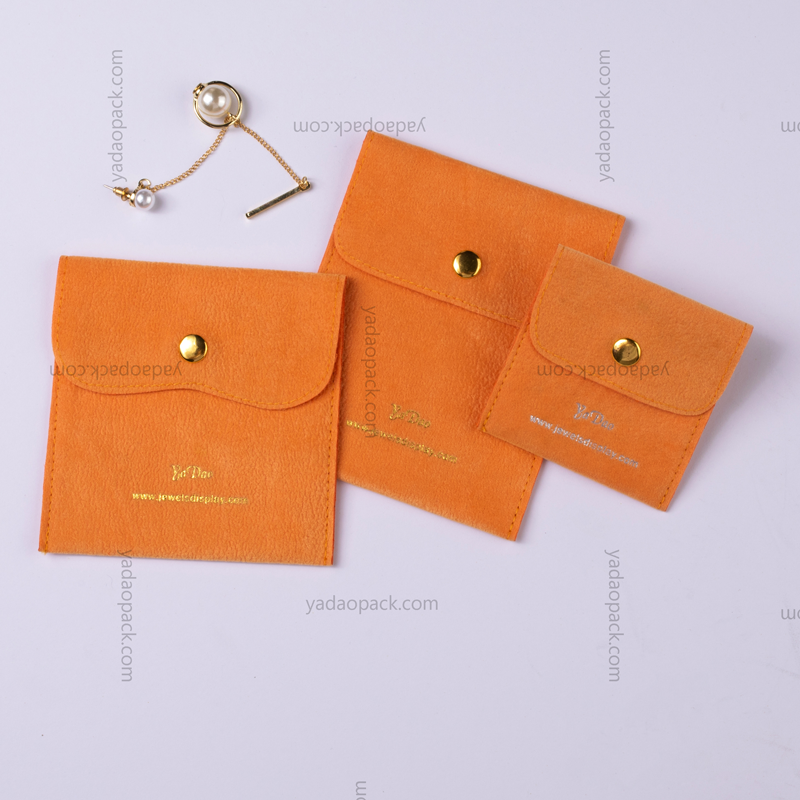 Bright orange velvet pouch with gold snap